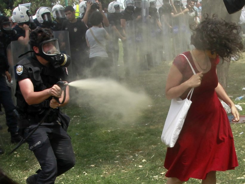 teargassed woman in red