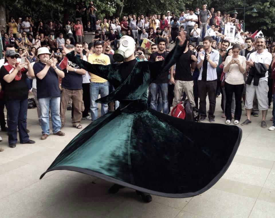 Whirling Sufi Protester wearing gas mask in a Gezi  Protest in Ankara, 2 June 2013