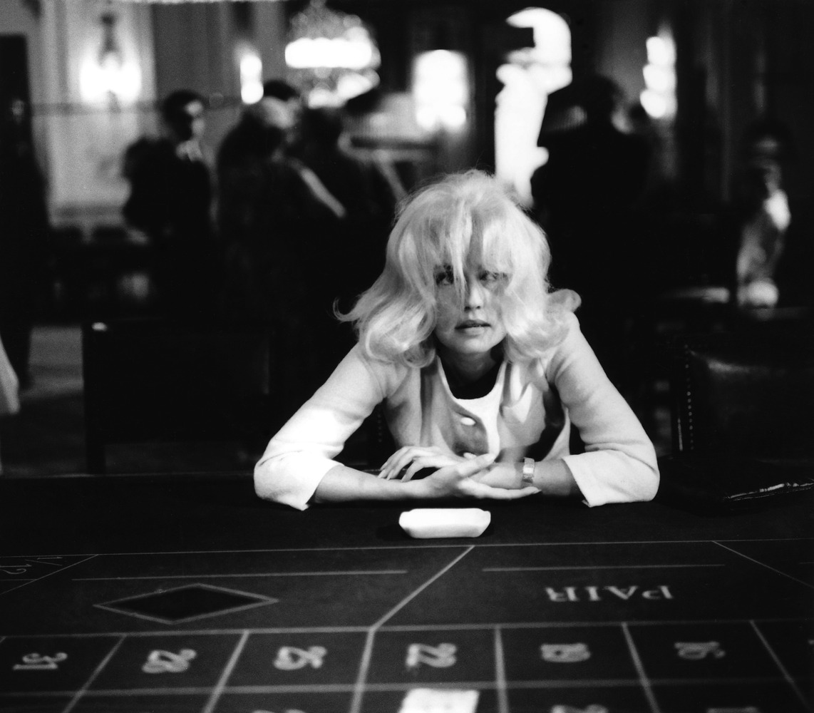 Jeanne Moreau at a betting table...