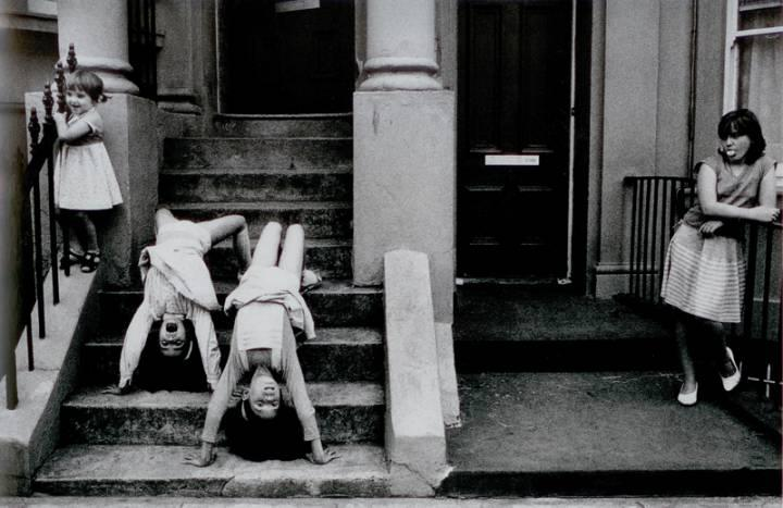 "Marketa Luskačová -  ""Girls upside down"". Blenheim Crescent, London, 1984, from the series 'Children in Britain'."