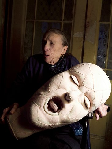 Louise Bourgeois with soft head sculpture, 2009.